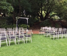 White Tiffany Chairs with black cushions