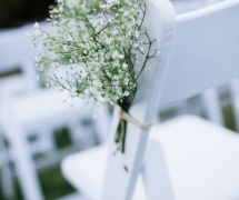 Baby Breath on White Ceremony Chairs